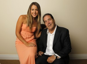 Music recording artist Colbie Caillat poses with her father, record producer Ken Caillat, in Beverly Hills